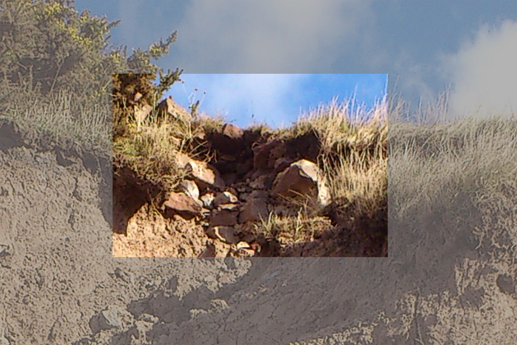 Picture of remains of old farm building falling onto the beach below eroding Thurstaston Cliffs